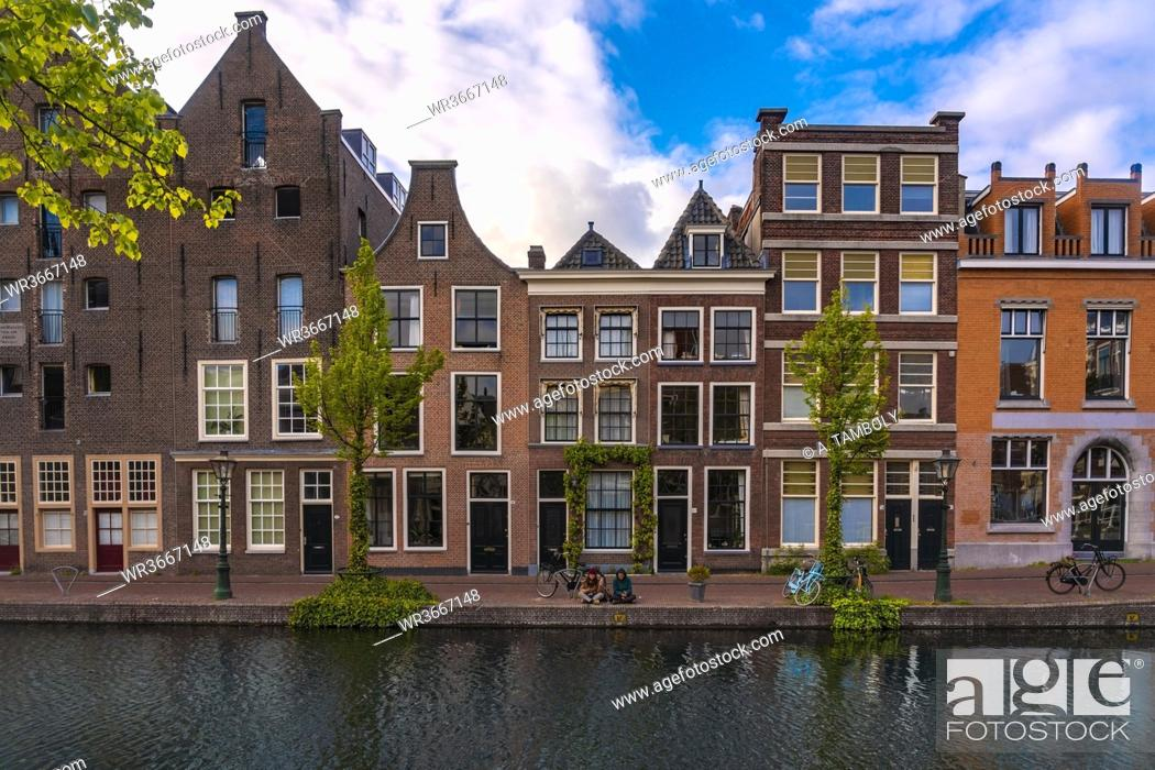 Stock Photo: Netherlands, South Holland, Leiden, Old historical houses alongOude Rijn canal.