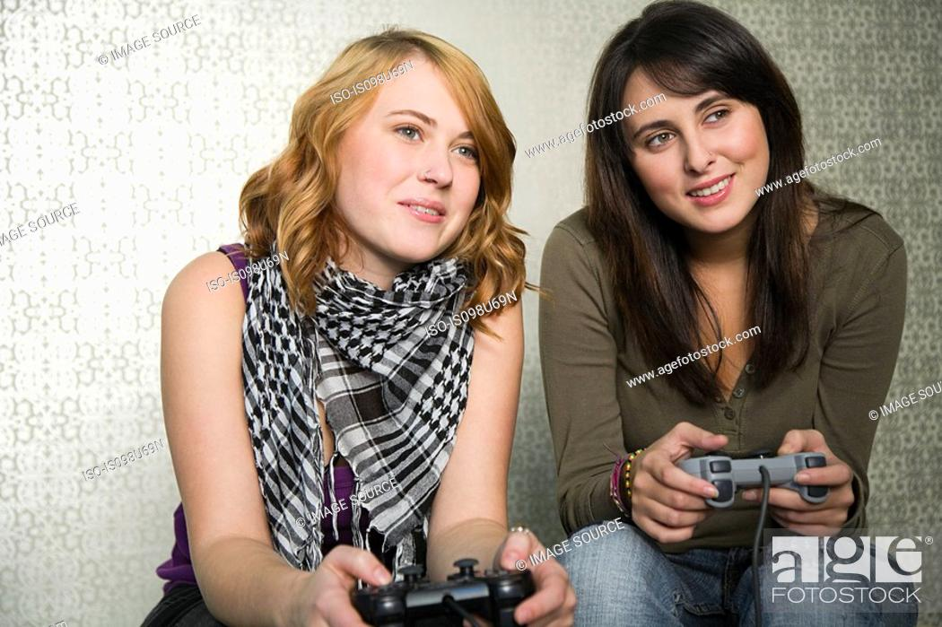 Stock Photo: Teenage girls playing on games console.