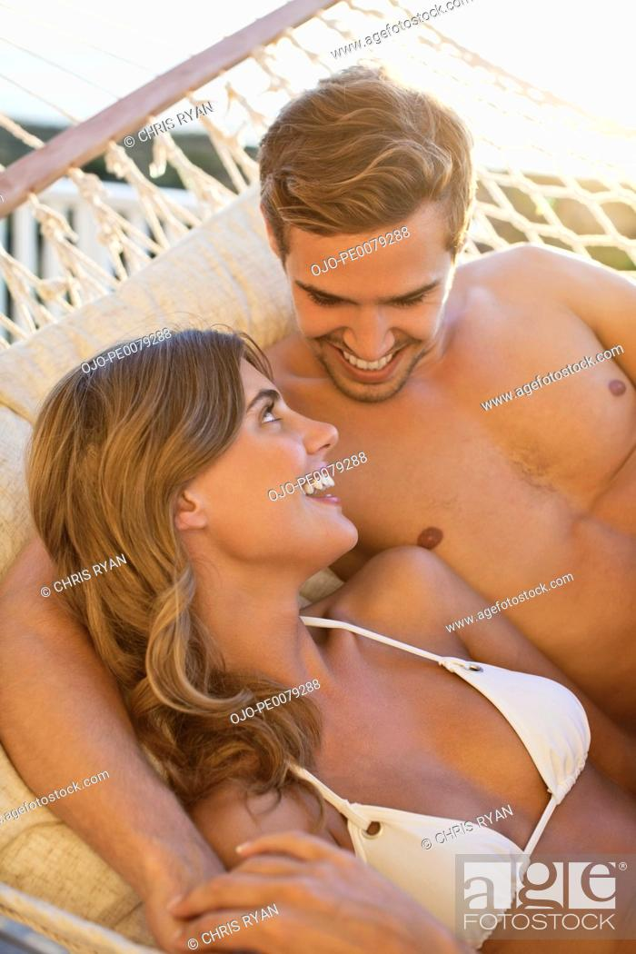 Stock Photo: Couple laying in hammock together.