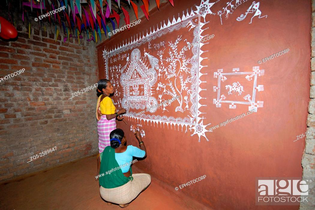 Warli tribe process of painting a dev chowk raitali village stock photo warli tribe process of painting a dev chowk raitali village dahanu maharashtra india thecheapjerseys Gallery