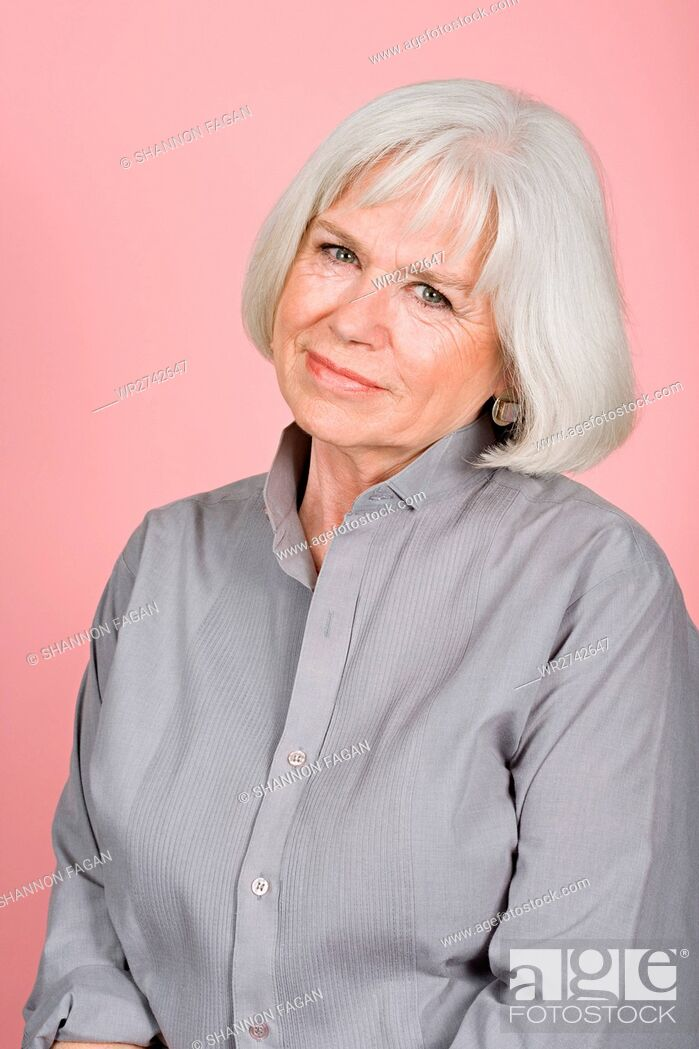 Stock Photo: Woman in a grey shirt.