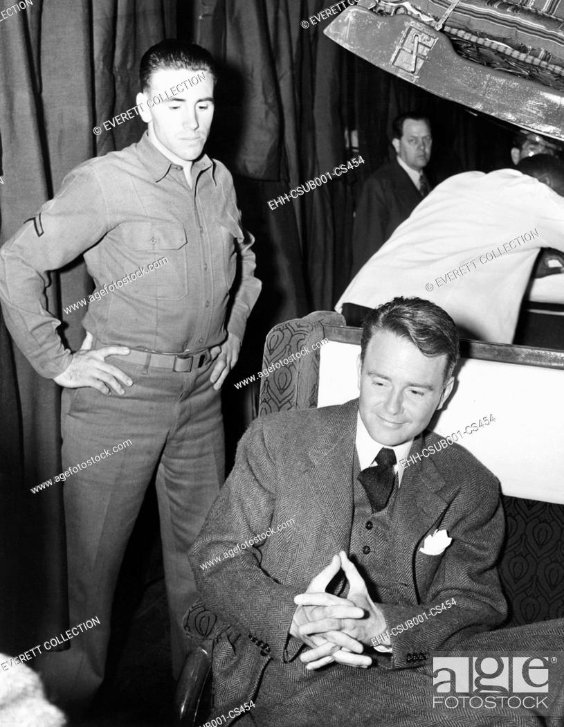Stock Photo: Conscientious objector, actor Lew Ayers, enroute to a labor camp at Cascade Locks Oregon. March 30, 1942. During World War II there were 152 Civilian Public.