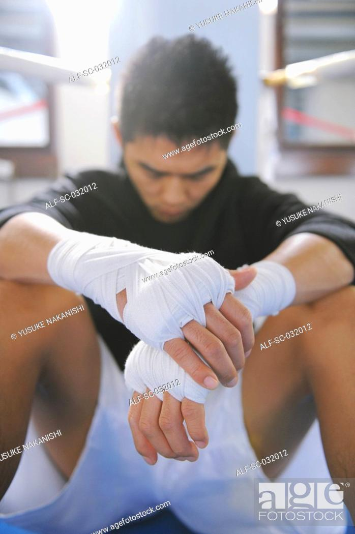 Stock Photo: Japanese boxer wearing bandage in his both hands.