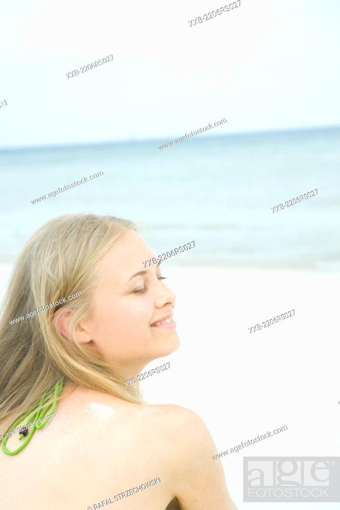 Stock Photo: woman sitting on beach.