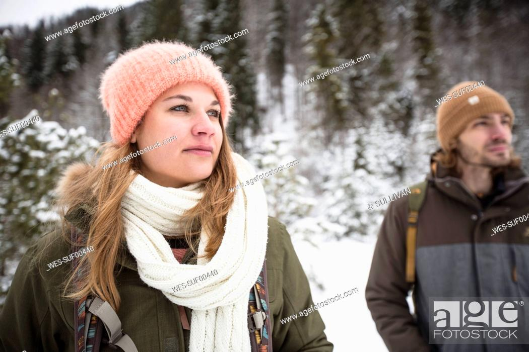 Stock Photo: Couple on a trip in winter looking around.