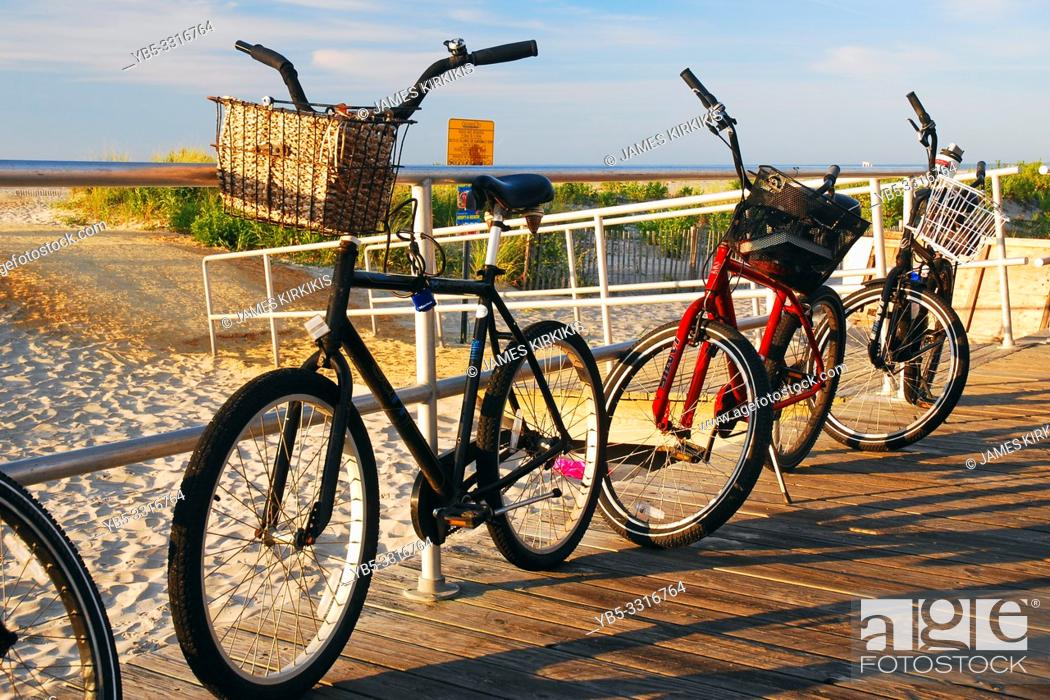 Stock Photo: Summer bikes are parked on the boardwalk along the Jersey Shore.