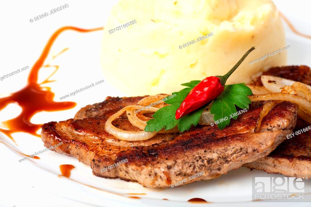 Stock Photo: pork steak with chili pepper.