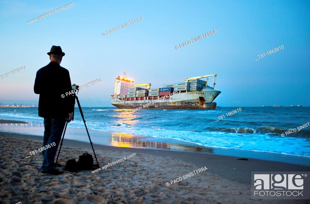 Stock Photo: Spain, Valencia, El Saler, Photographer and Boat on Beach.