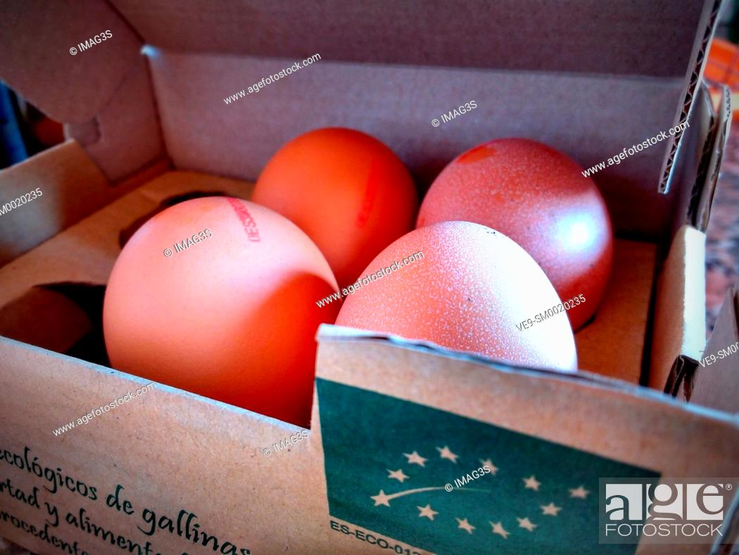 Stock Photo: Organic eggs in a box, identified with the European organic label.