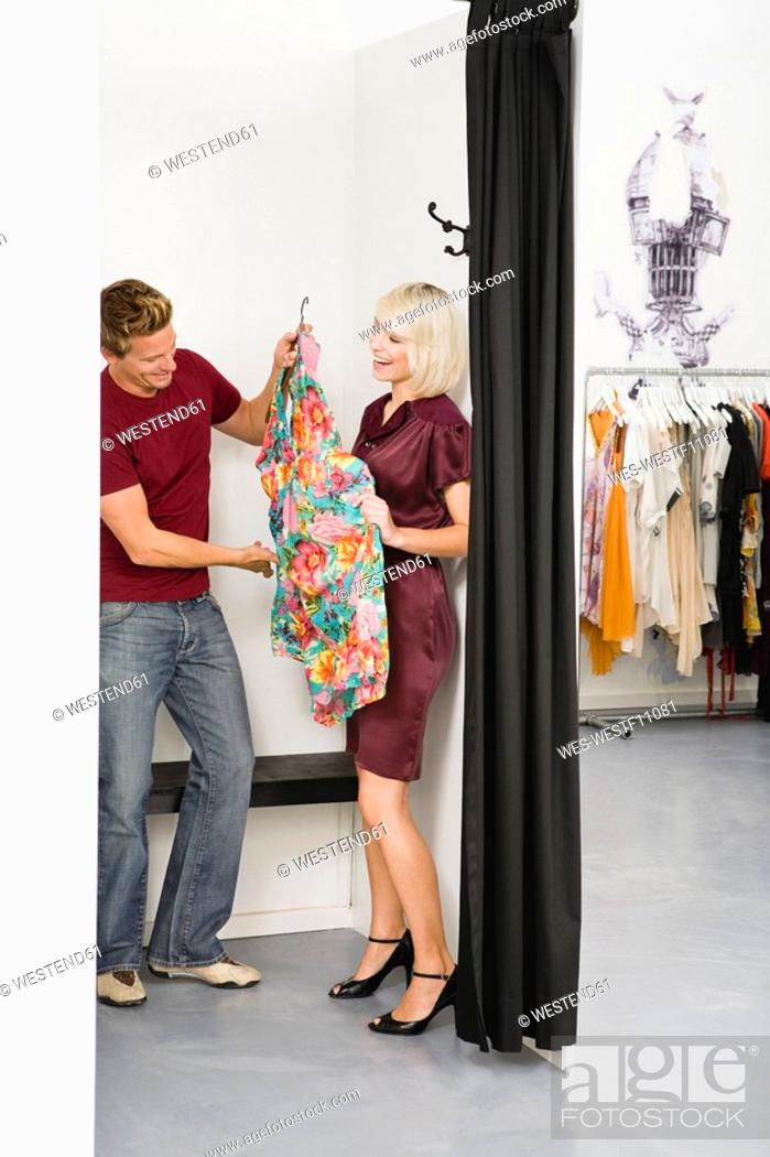 Stock Photo: Young couple in fashion shop.
