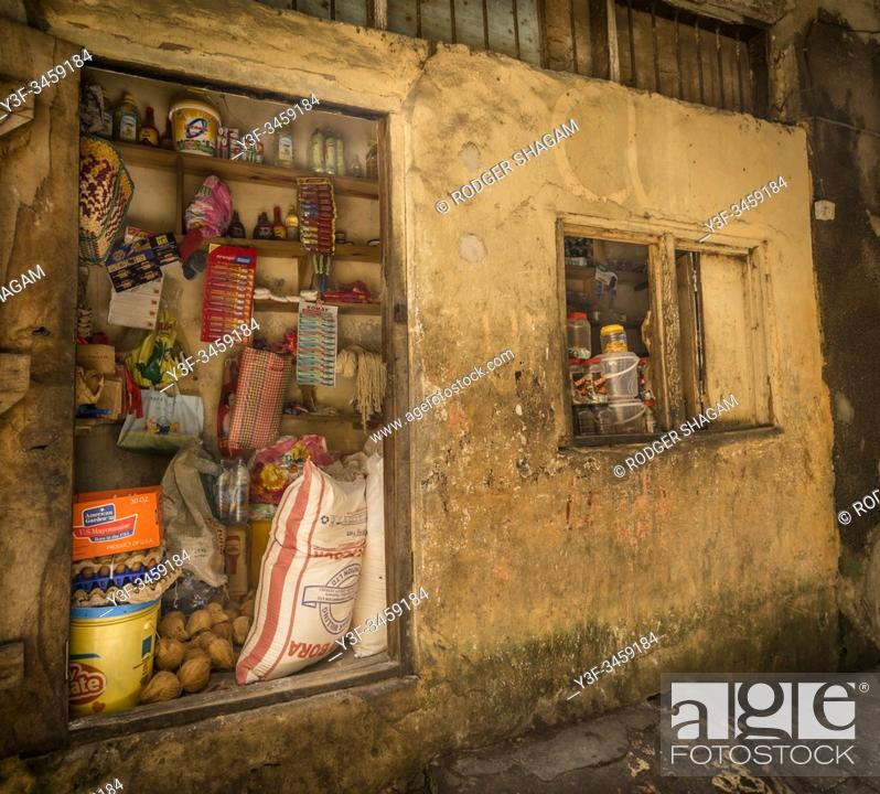 Stock Photo: Zanzibar. Grocer shop in a typical Stone Town alley.