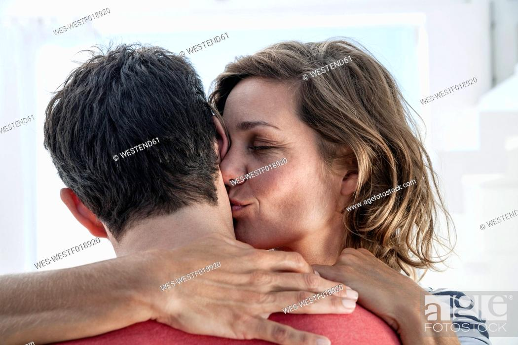 Stock Photo: Spain, Mid adult woman kissing to man.