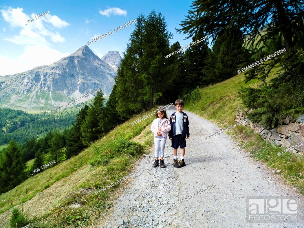 Stock Photo: Children make an excursion in the Stelvio National Park, Purple Valley, Bormio, Lombardy, Italy.