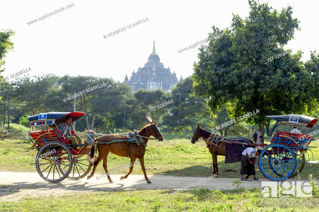Stock Photo: Myanmar (ex Birmanie). Bagan, Mandalay region. Horse-drawn carriage tourists.