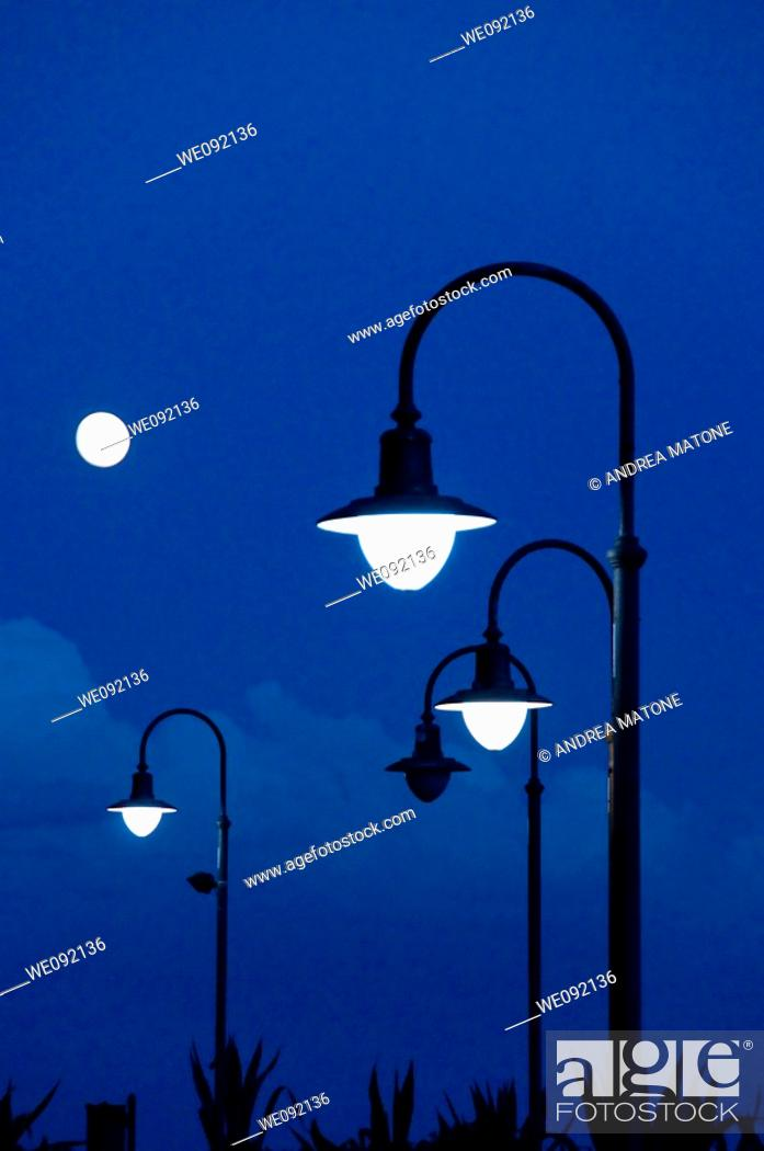 Stock Photo: Street lamps at dusk.