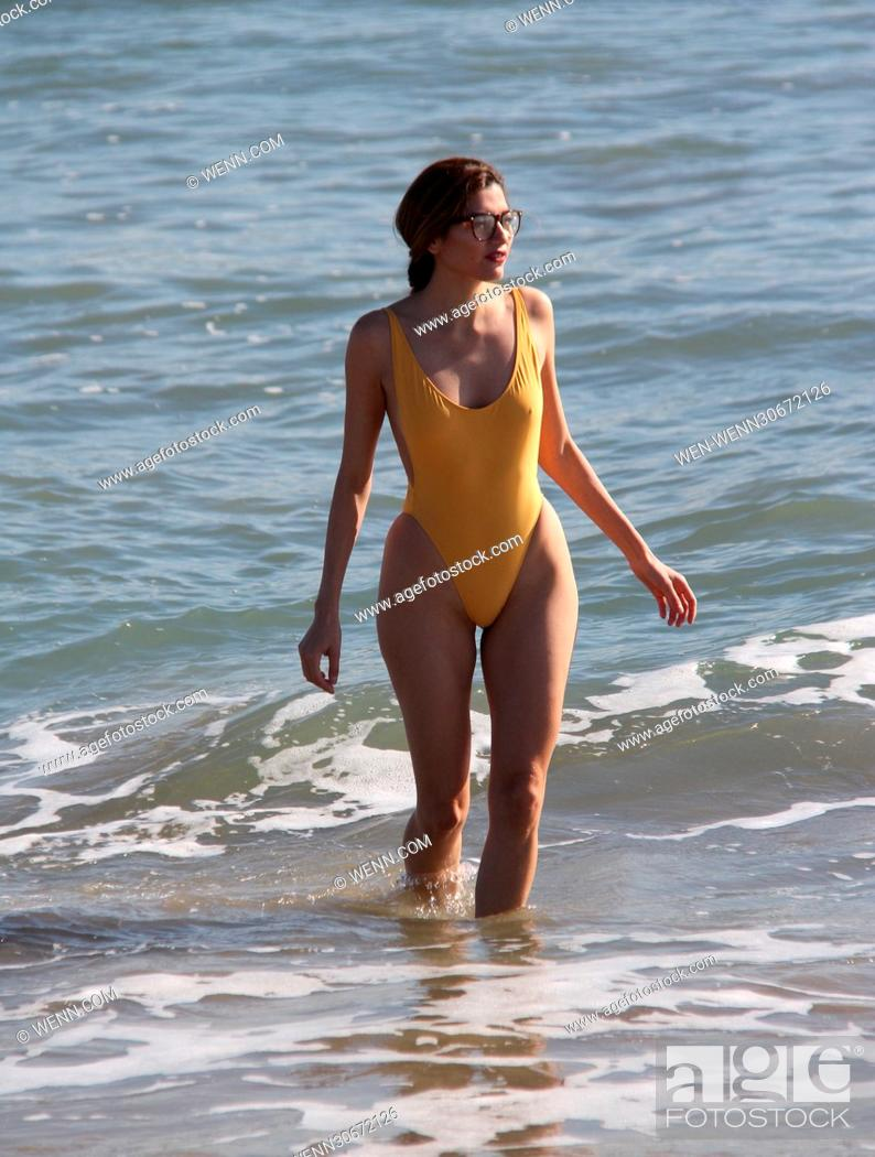 0aebecf09d Stock Photo - Blanca Blanco poses in a yellow swimsuit during a New Year s  Day photoshoot on Malibu Beach Featuring  Blanca Blanco Where  Malibu
