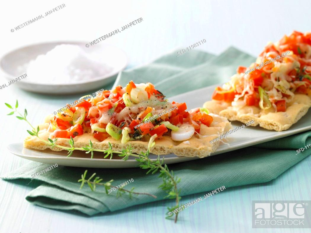 Stock Photo: Gratinated peppers on bread with spring onions.
