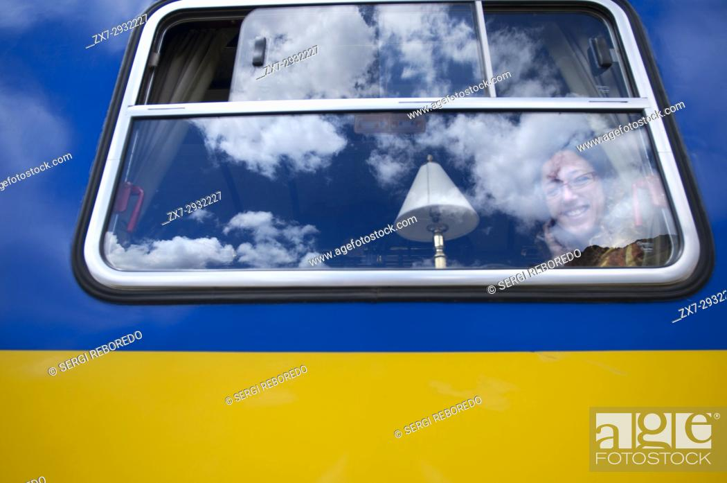 "Stock Photo: Andean Explorer, luxury train from Cusco to Puno. Andean Explorer train window Perurail runs between Cuzco and Puno. """"Between The Pleasure & The Legendâ."