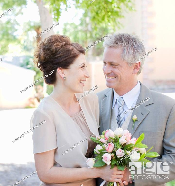 Stock Photo: Mature bride and groom smiling.