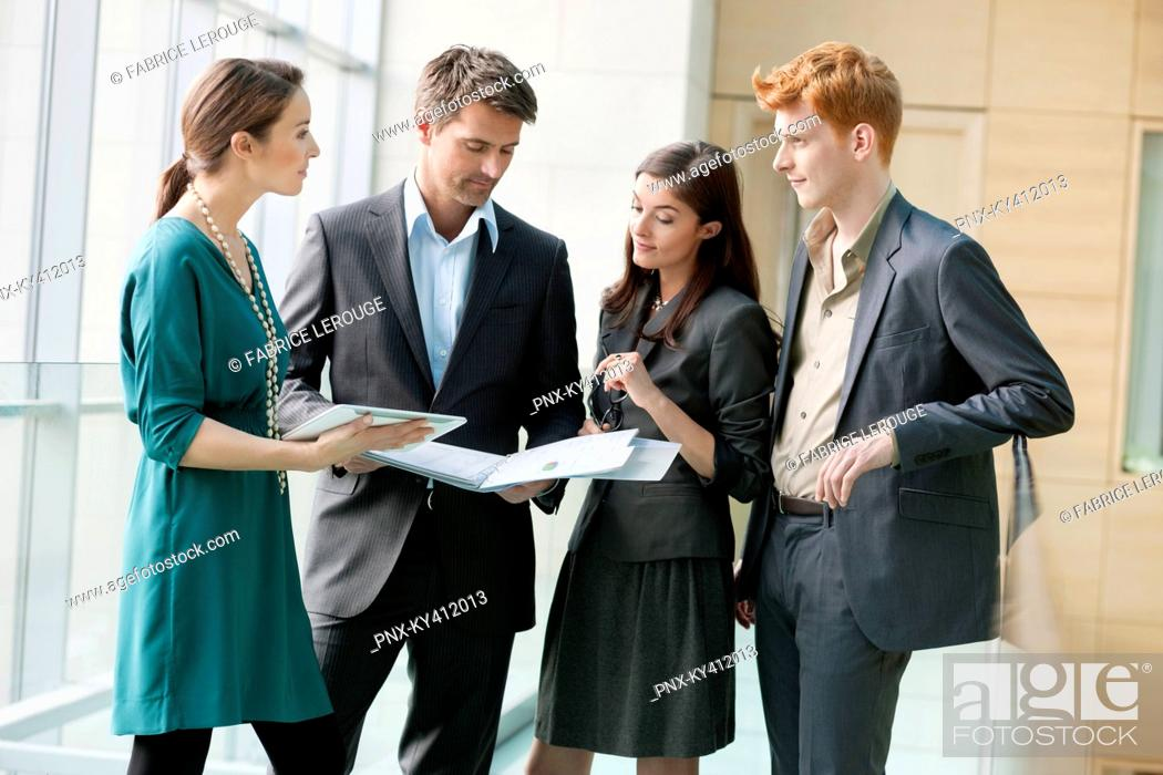Stock Photo: Business executives working in an office.
