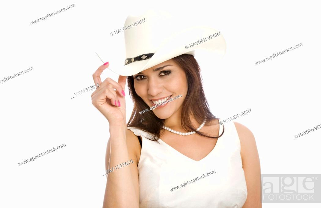 Stock Photo: young woman wearing a cowboy hat.