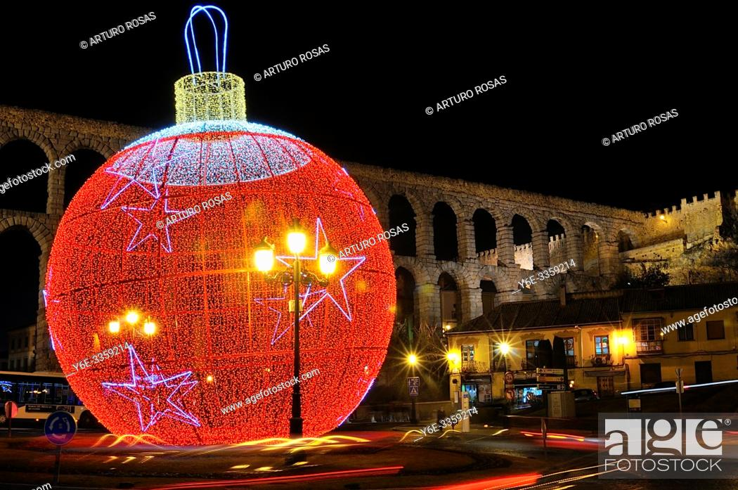 Stock Photo: The big Christmas Tree ball in the front of the aqueduct of Segovia.