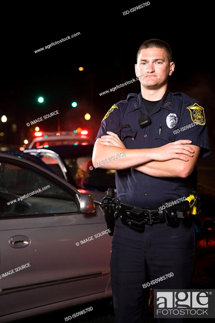 Stock Photo: Police officer at scene of accident.