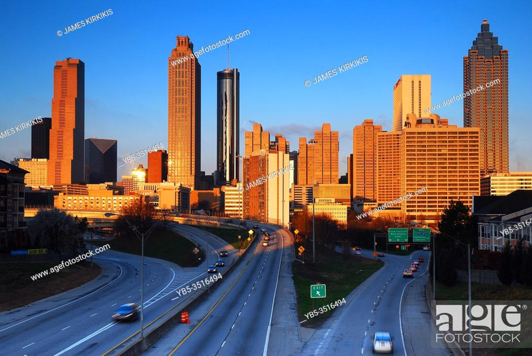Stock Photo: The early sun shines on the skyline of midtown Atlanta.