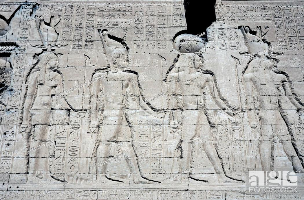 Stock Photo: Dendera Egypt, ptolemaic temple dedicated to the goddess Hathor. Carvings on external wall.