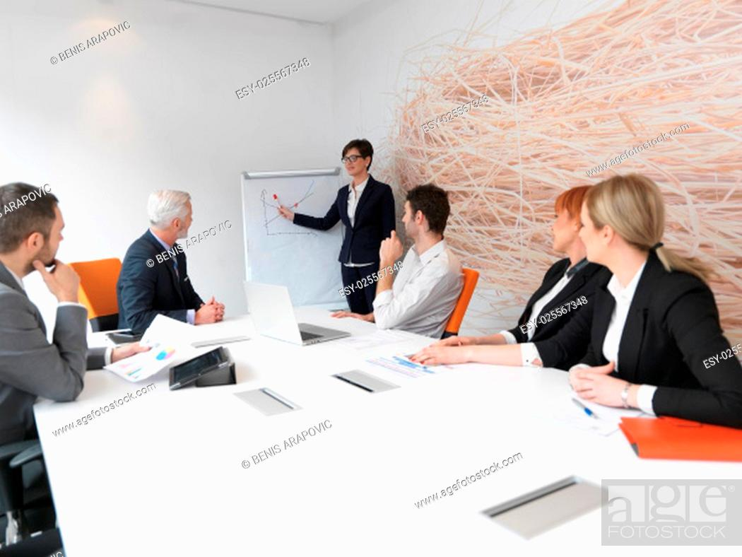 Stock Photo: business people group on meeting at modern bright office indoors. Senior businessman as leader in discussion.