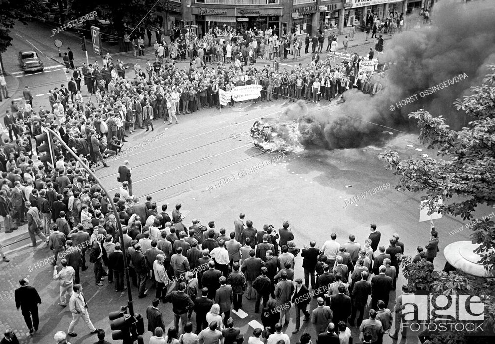 Stock Photo: Burning car in Duesseldorf during a student demonstration on 12 June 1968. Students had brought an old, not functional car to burn.