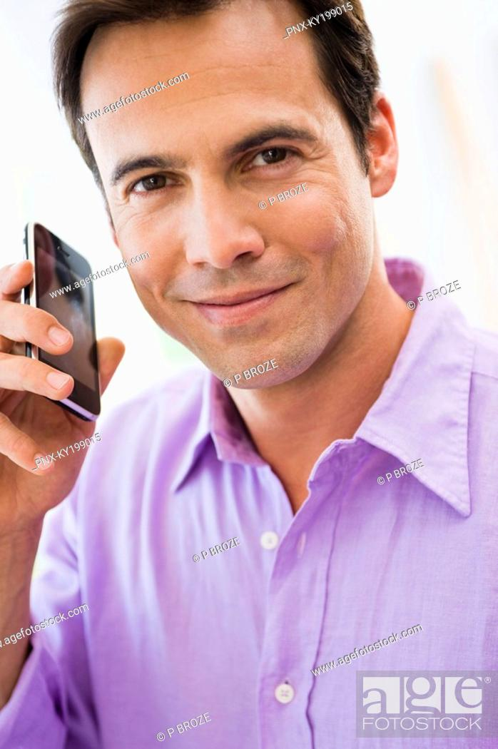 Stock Photo: Portrait of a man talking on a mobile phone.