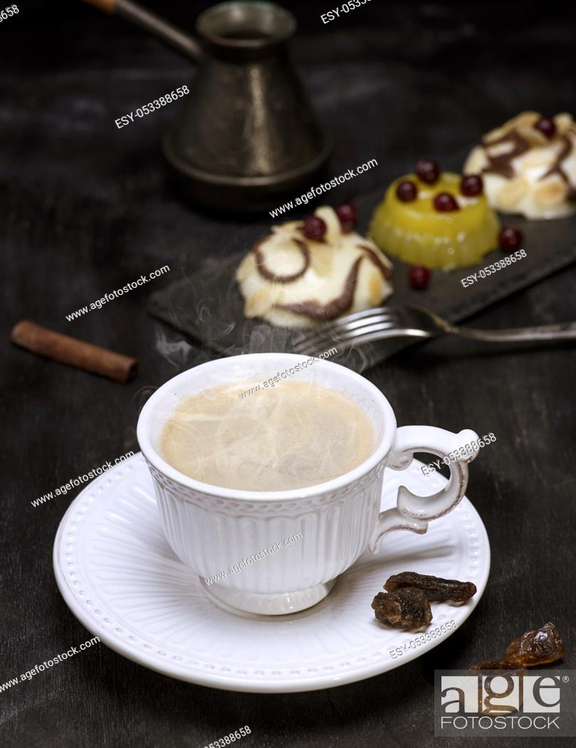 Stock Photo: White ceramic cup with black coffee, top view.