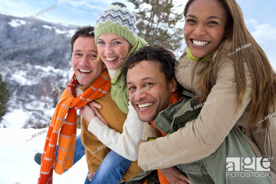 Stock Photo: Portrait of happy couples in winter setting.
