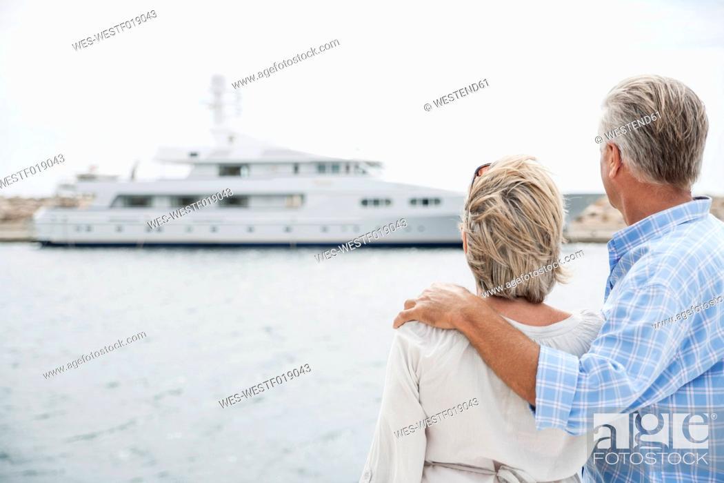 Stock Photo: Spain, Senior couple at harbour.