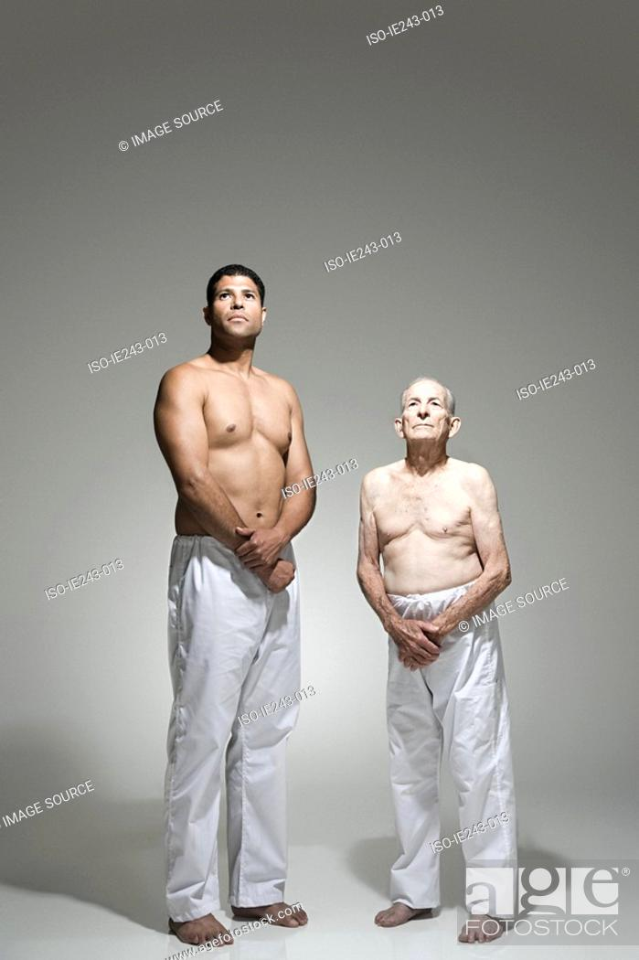 Stock Photo: Yound and old man standing together.
