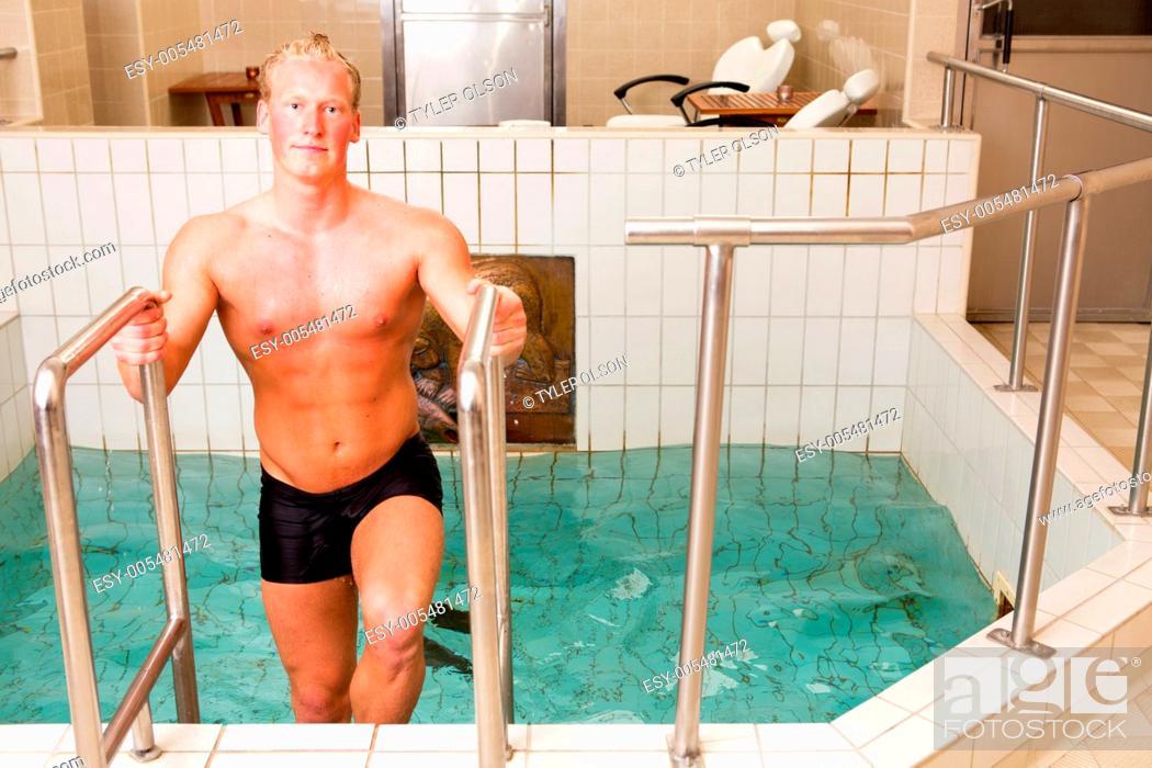 Stock Photo: Man Exiting Pool.