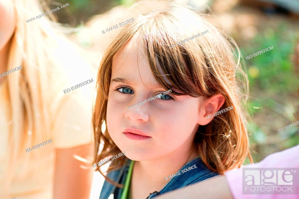 Stock Photo: Pensive girl looking at camera, portrait.
