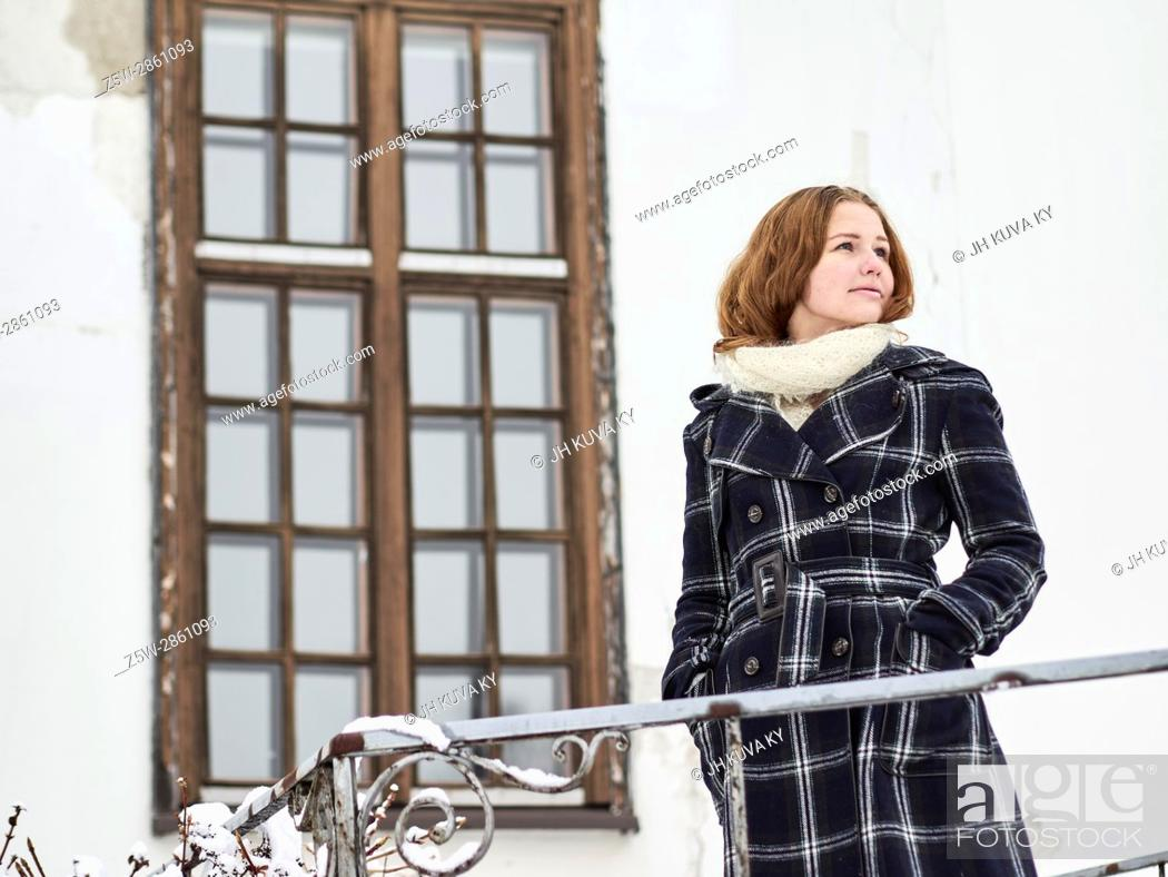 Stock Photo: Beautiful young girl wearing a winter coat and she posing, Finnish winter day on February.