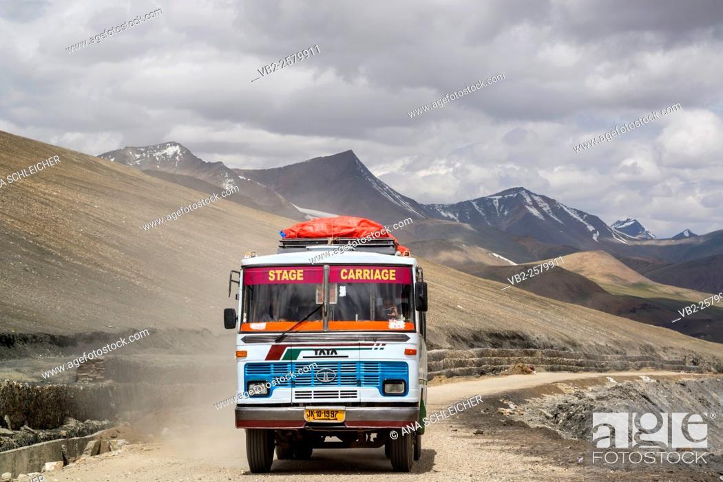 Stock Photo: Public bus achieving Taglang La (5328m). Second highest motorable pass of the World. Ladakh (india).
