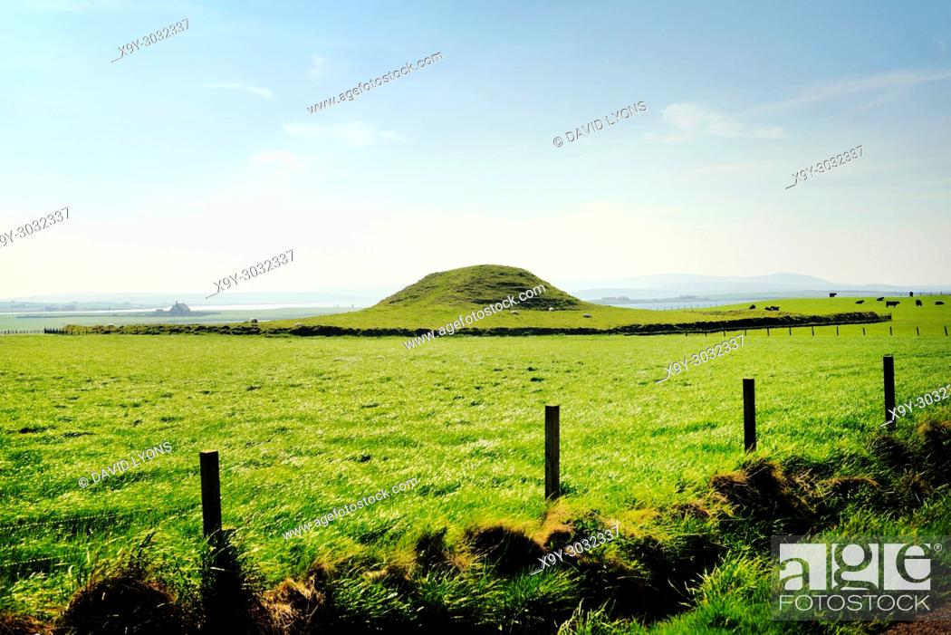 Stock Photo: Maes Howe Neolithic chambered cairn passage grave. Mainland, Orkney, Scotland. 5000 years old. Stenness (L) and Brodgar (R) stones in distance.
