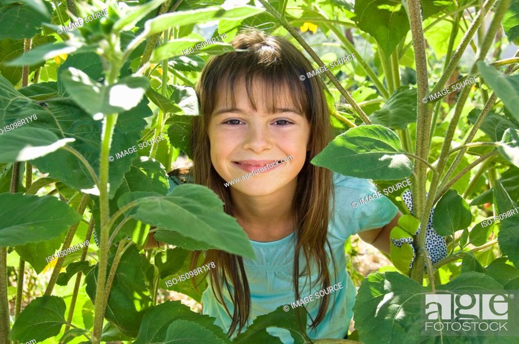 Stock Photo: Girl and plants.