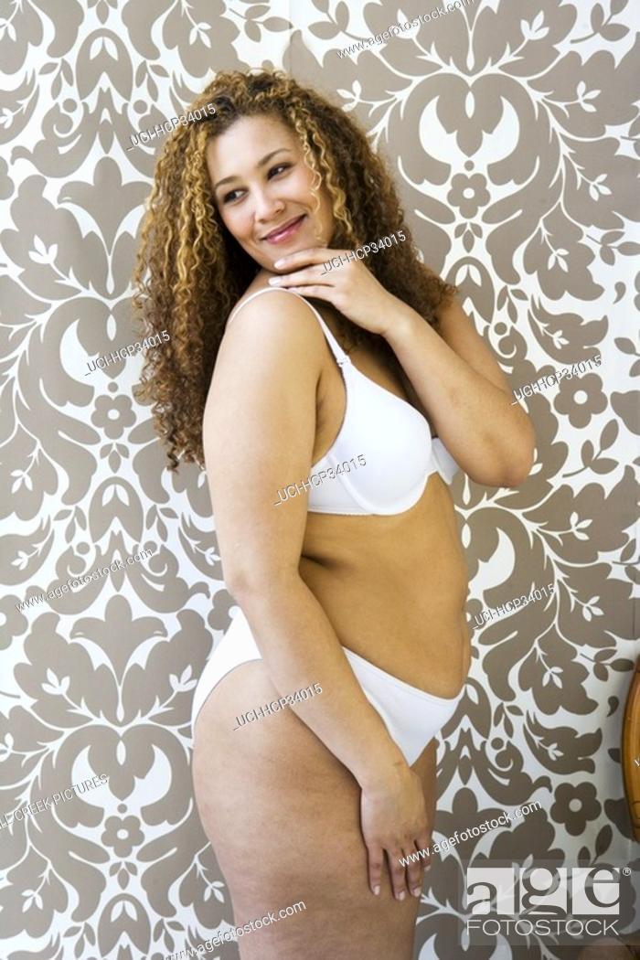 Stock Photo: Woman wearing bra and panties looking over her shoulder.