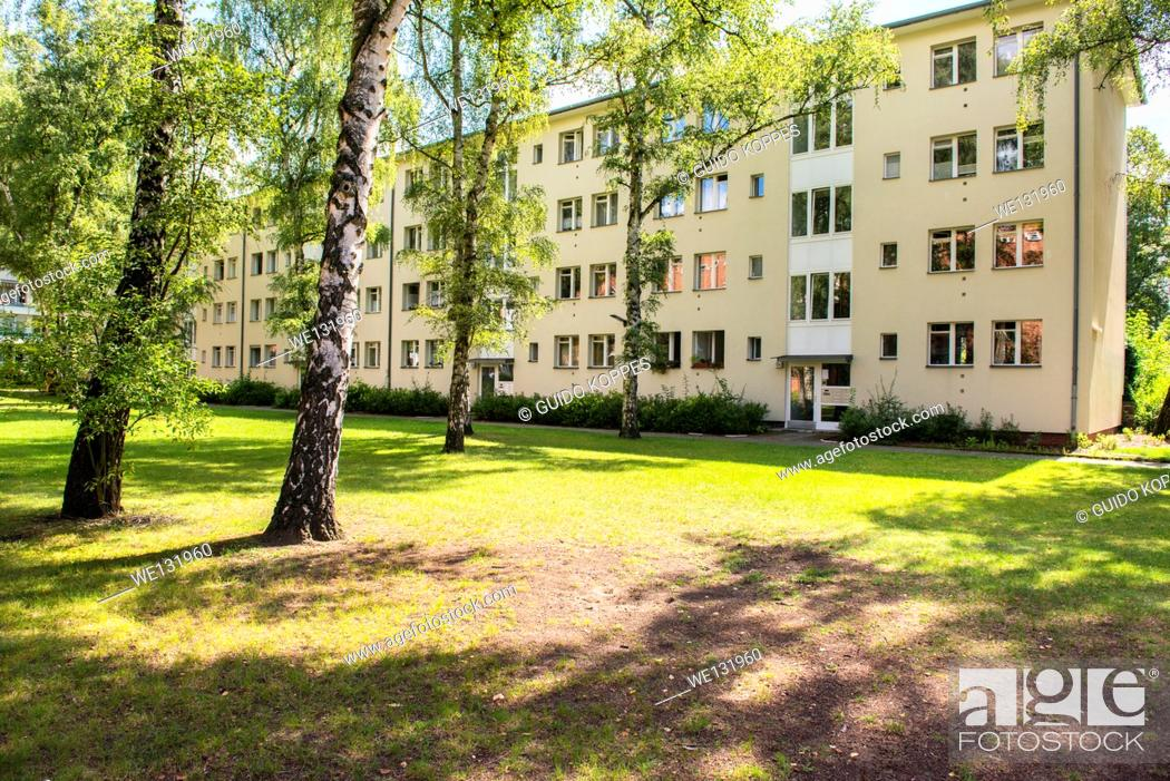 Stock Photo: Berlin, Germany. UNESCO site: Schiller Park Sietlung with houses and apartment buildings in a residential area.