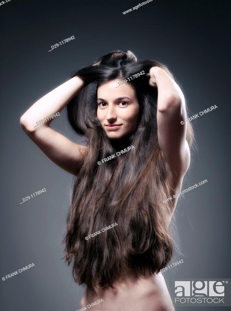 Stock Photo: woman with very long brown hair.