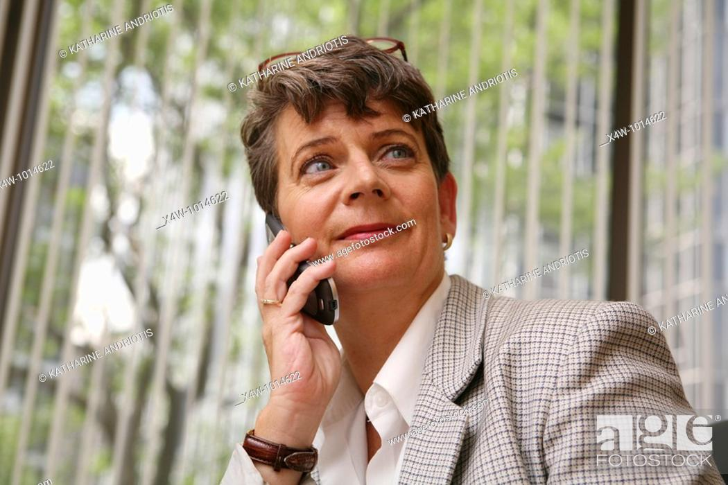 Stock Photo: Businesswoman on mobile phone.