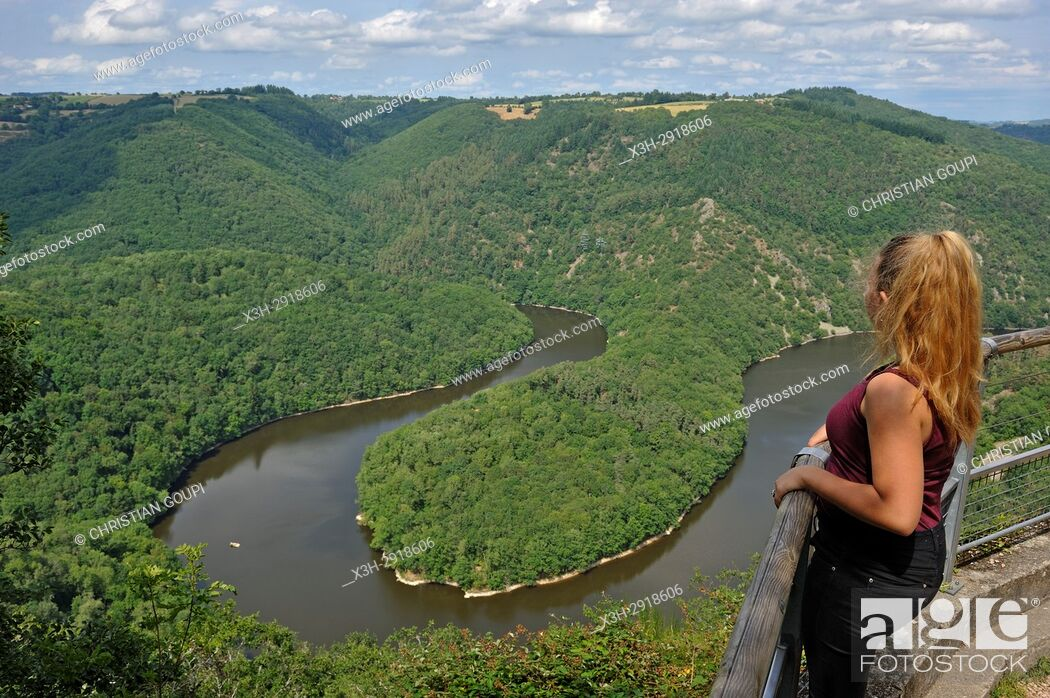 Stock Photo: young girl admiring the Queuille's meander (Meandre de Queuille) of the Sioule River from the ''Paradis'' viewpoint, Puy-de-Dome department.