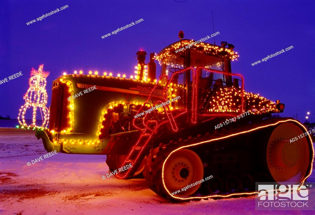Agriculture - A John Deere tracked tractor decorated with Christmas ...
