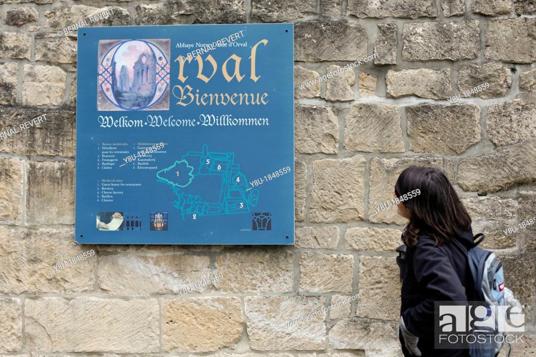 Stock Photo: A tourist looks at the entrance sign at Orval Abbey in Villers-Devant-Orval, Belgium.
