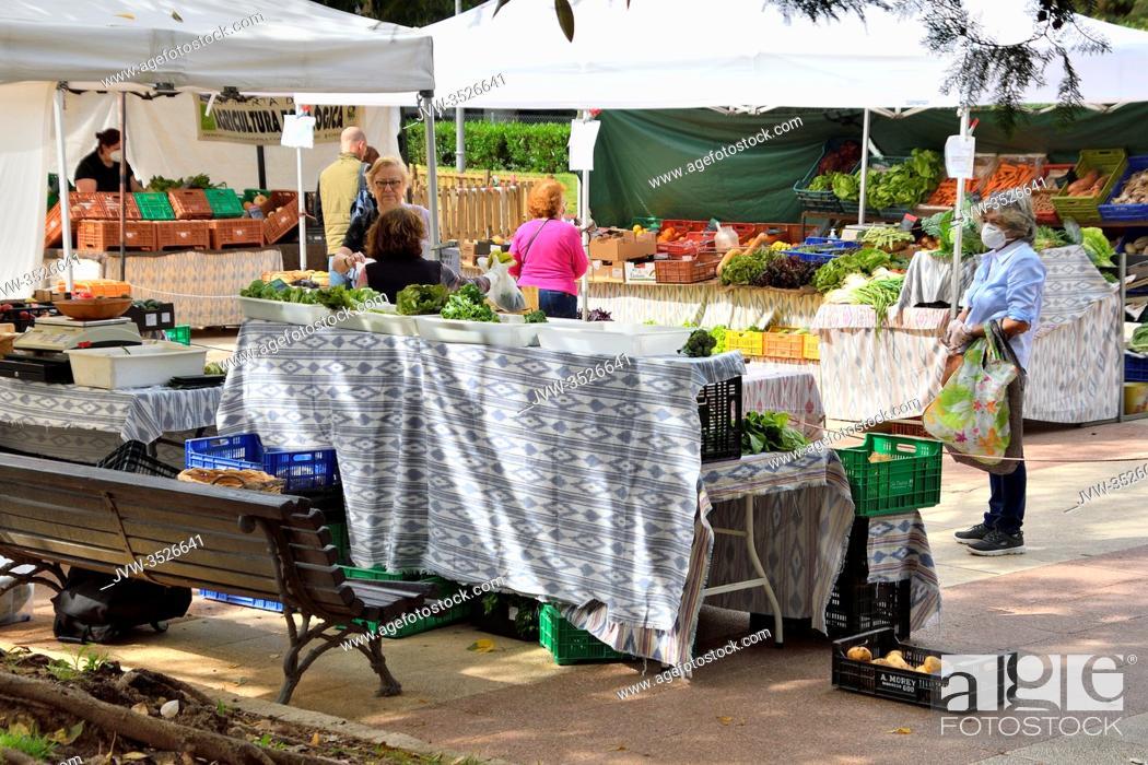 Photo de stock: People at an outdoor market in Palma de Mallorca, Spain.